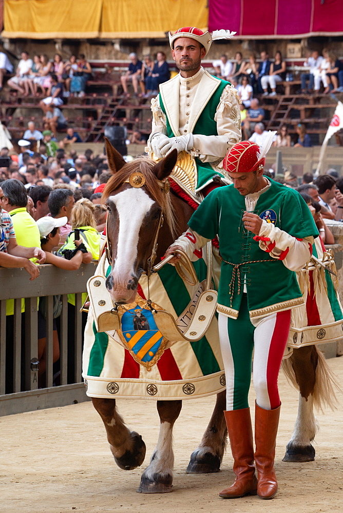 At the pageant that precedes the Palio race, representatives and riders of each neighbourhood parade in traditional costume, Siena, Tuscany, Italy, Europe - 450-4424
