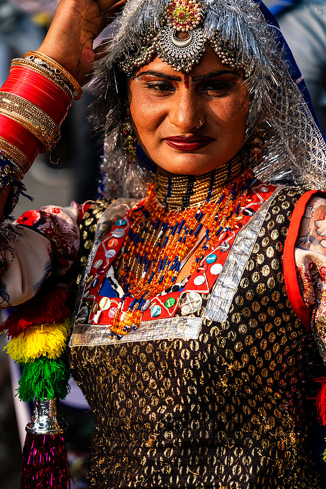 Dancer in brightly coloured traditional clothing in the inauguration procession for the Chandrabhaga Fair, Jhalawar, Rajasthan, India, Asia