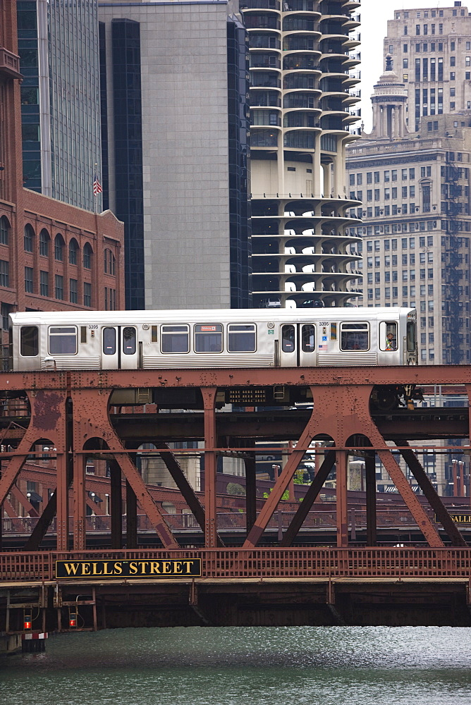 An El train on the Elevated train system crossing Wells Street Bridge, Chicago, Illinois, United States of America, North America - 462-2259