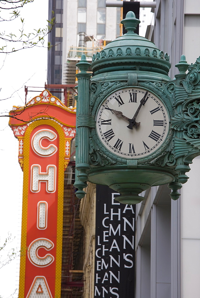The Marshall Field Building Clock and Chicago Theatre behind, Chicago, Illinois, United States of America, North America