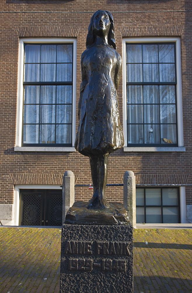 Statue of Anne Frank outside Westerkerk church, Amsterdam, Netherlands, Europe