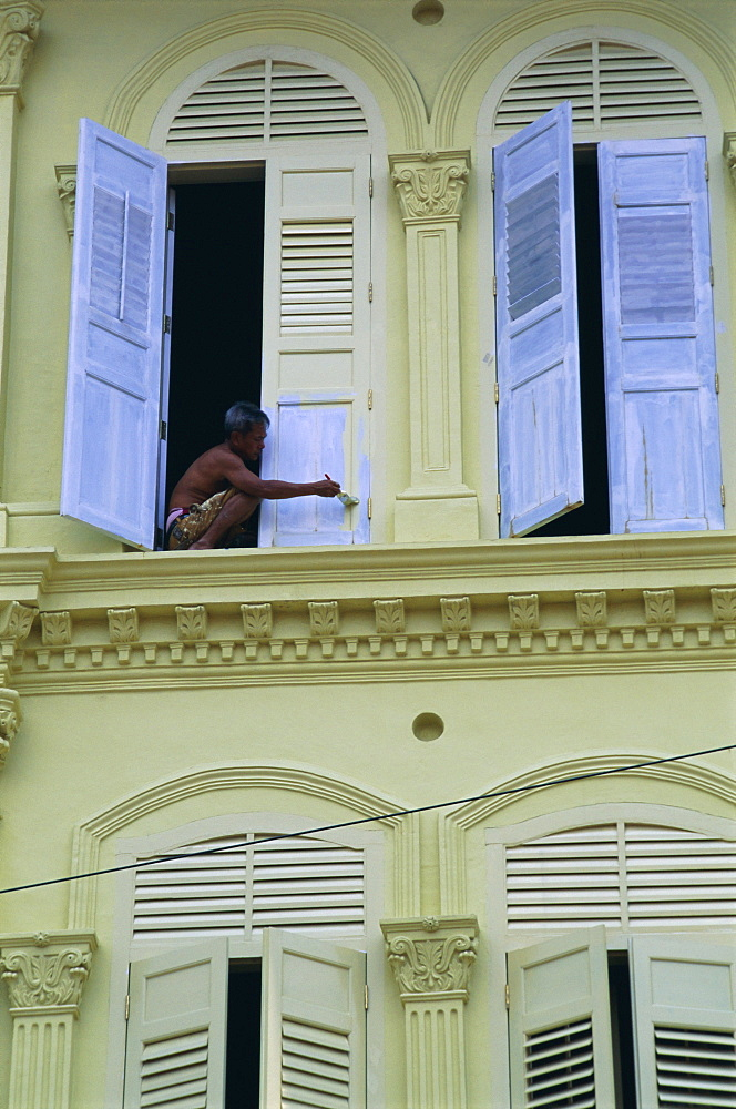 Man painting shutters on a house, Chinatown, Singapore, Asia