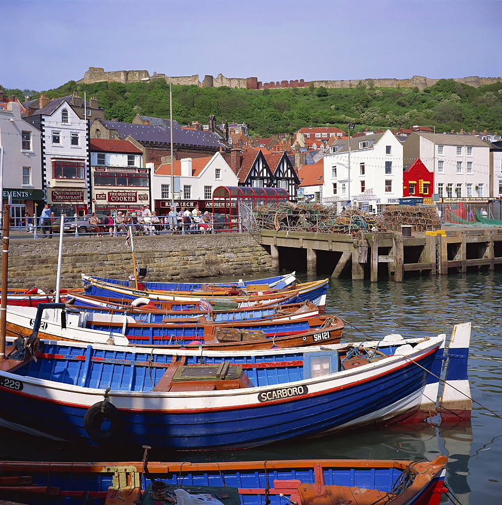 Fishing boats in the harbour, with the castle on the hill behind, Scarborough, Yorkshire, England, United Kingdom, Europe