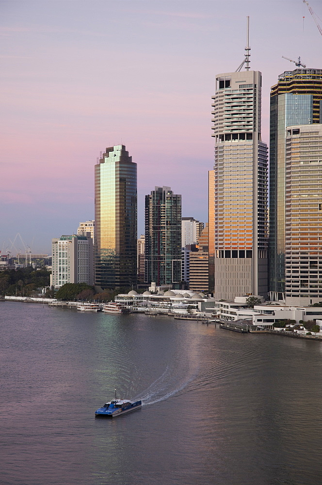 Catamaran ferry on Brisbane River and city centre, Brisbane, Queensland, Australia, Pacific