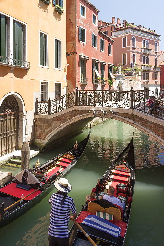 Gondola passing under a bridge over a small canal, Venice, UNESCO World Heritage Site, Veneto, Italy, Europe - 489-1706