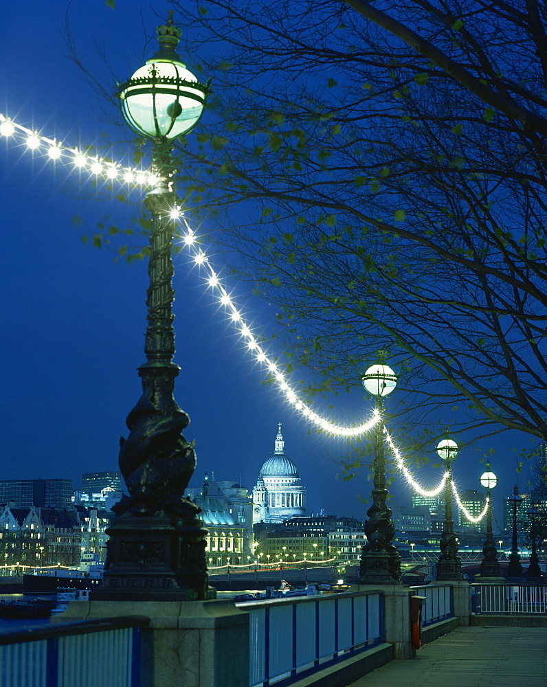 South Bank street lamps and city skyline, including St.Paul's Cathedral, illuminated at night, seen from across the Thames, London, England, United Kingdom, Europe - 505-1176
