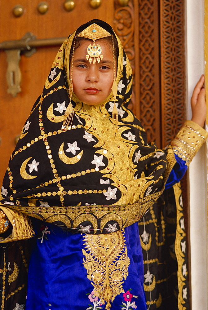 Young girl in traditional dress, Bahrain, Middle East