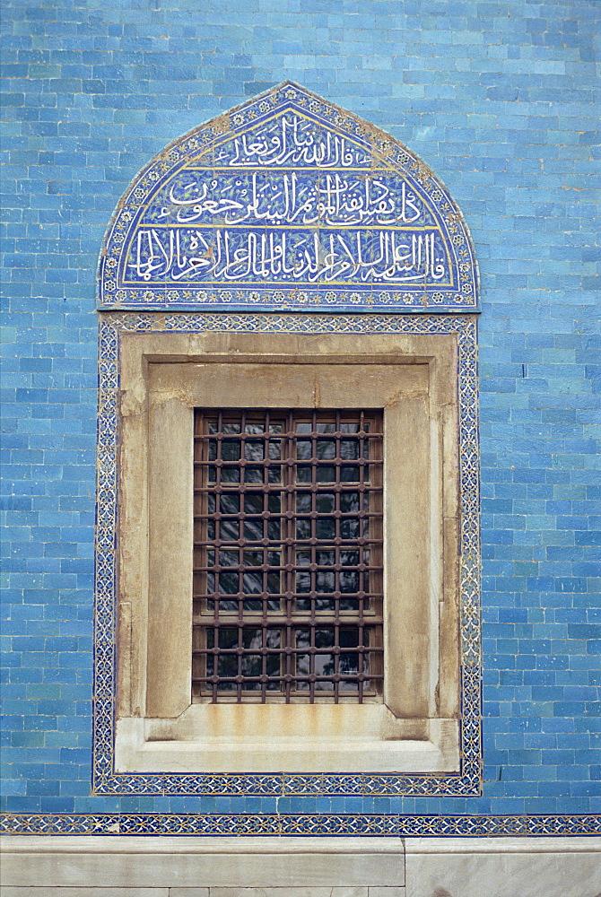 Detail of window with Arabic script on tilework above, in the Green Mosque in Bursa, Anatolia, Turkey, Asia Minor, Eurasia