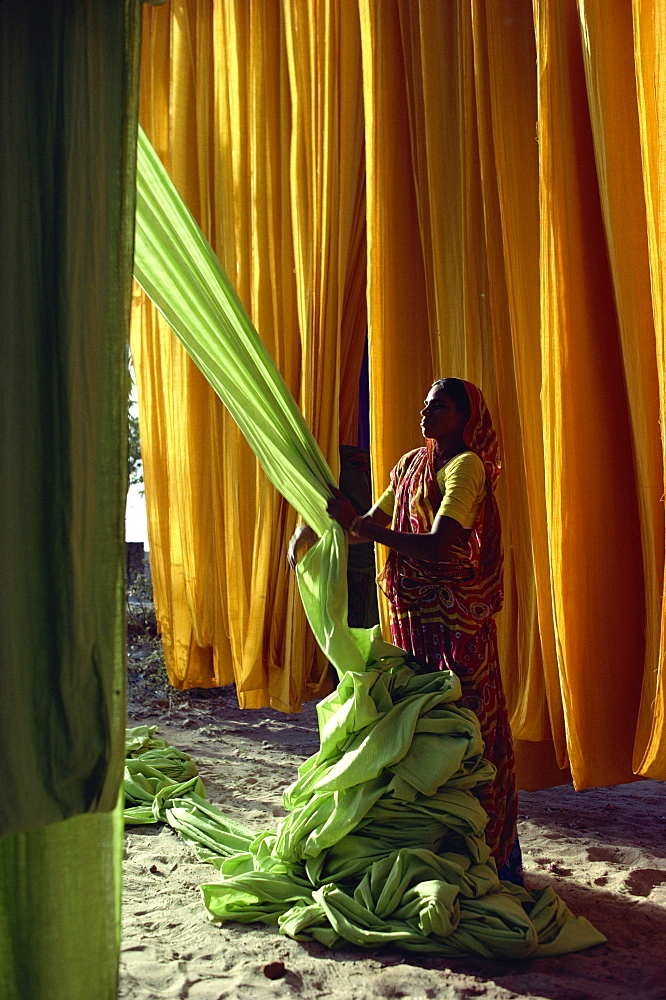 Woman working with textiles, Ahmedabad, Gujarat, India, Asia