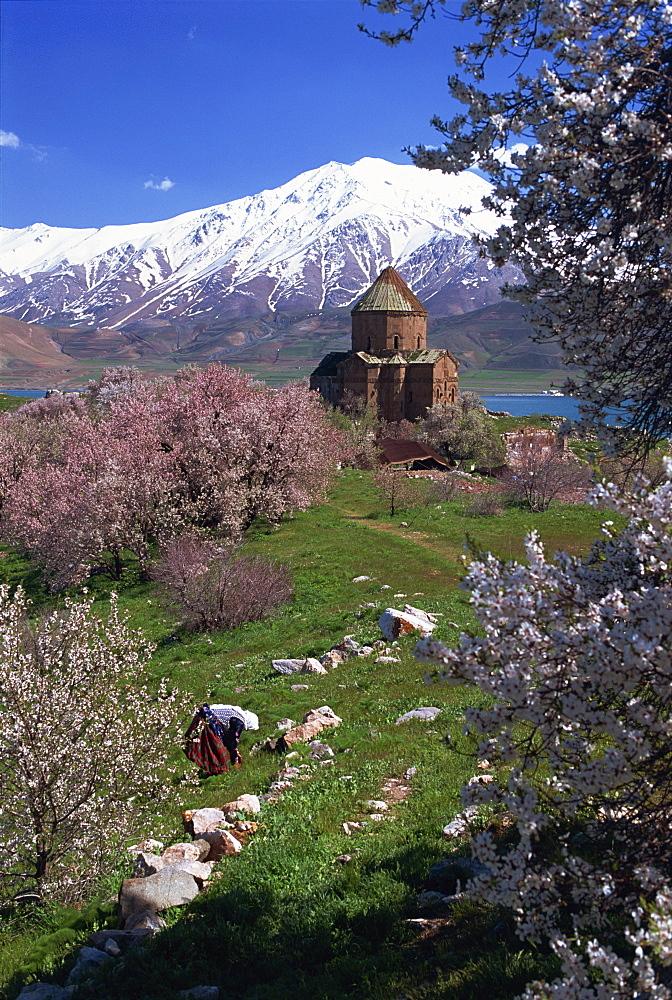 Figure at work below the Armenian Church of the Holy Cross, on Akdamar Island, beside Lake Van, Anatolia, Turkey, Asia Minor, Eurasia