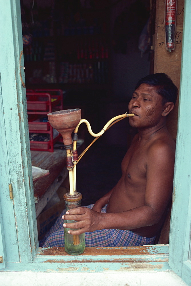 Shopkeeper with hookah, Male, Maldive Islands, Indian Ocean, Asia