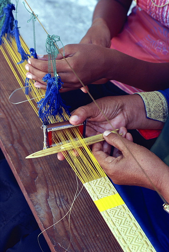 Weavers hands using a narrow loom in the Maldive Islands, Asia