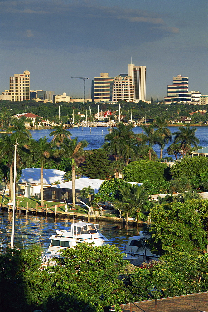 Aerial view over boats and houses on the harbour with the Fort Lauderdale skyline behind, Florida, United States of America, North America