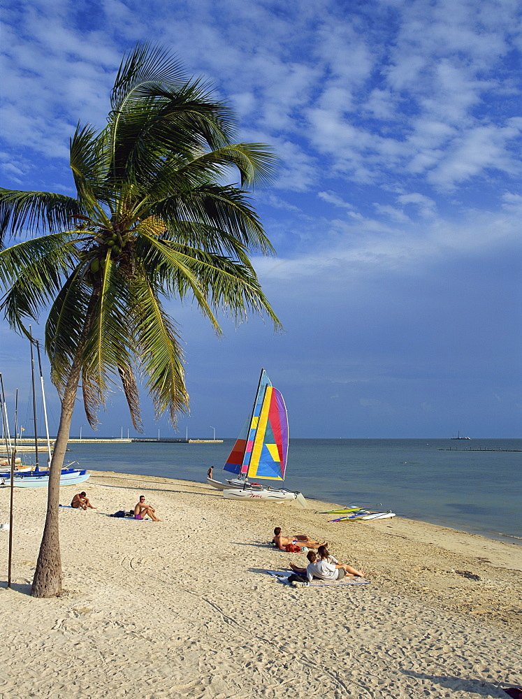 People on the beach in the late afternoon, Key West, Florida, United States of America, North America