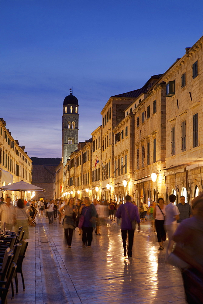 Placa, Stadun, lit up at dusk with cafes and people walking, Dubrovnik, Croatia, Europe - 526-3773