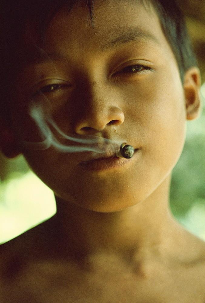Kenyah boy smoking, Sarawak, Malaysia, Southeast Asia, Asia - 54-2797