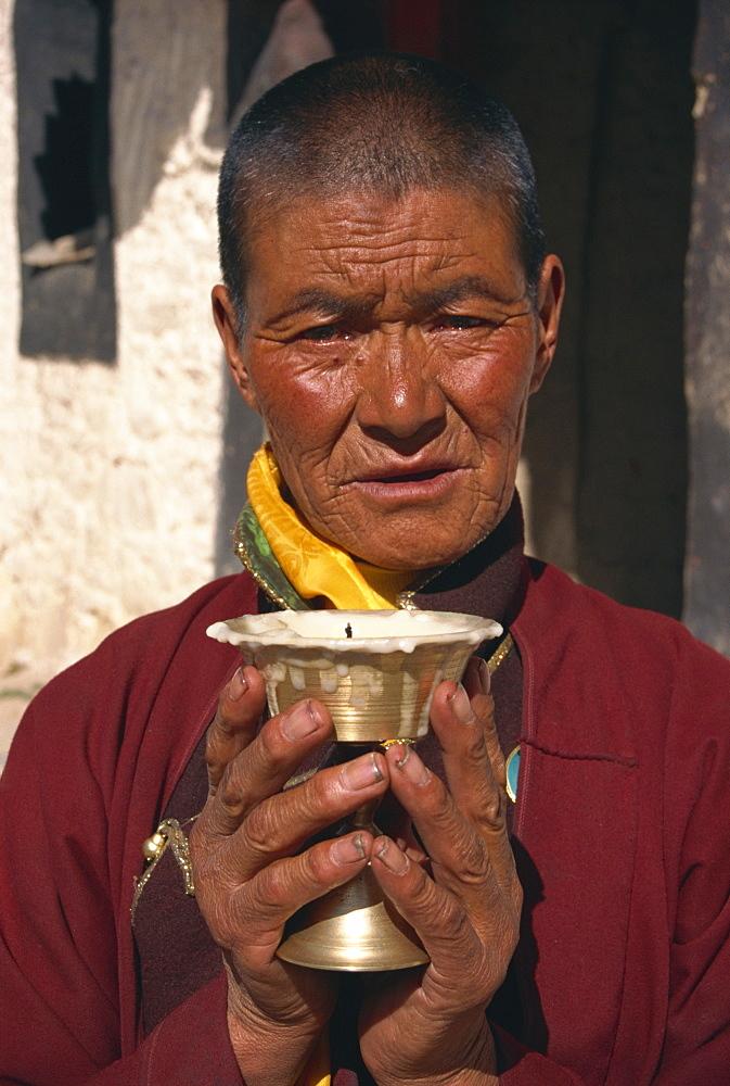Woman on pilgrimage, Ganden Monastery, Tibet, China, Asia