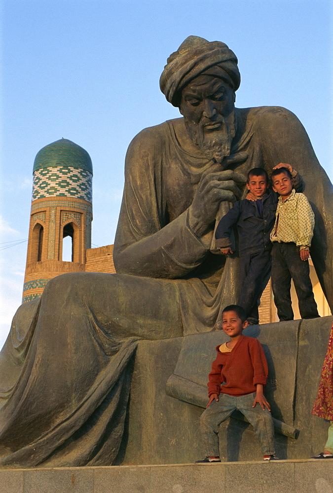 Children playing on statue of Uzbek poet, Khiva, Uzbekistan, Central Asia, Asia