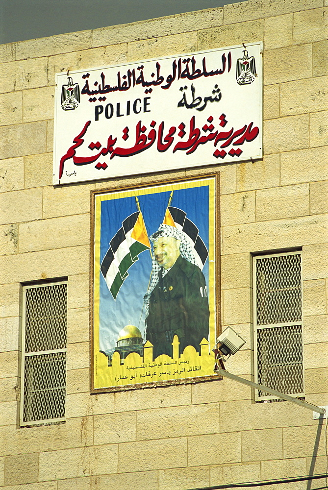 Poster showing Yasser Arafat on the wall of a Palestinian Police Station in Bethlehem, Israel, Middle East