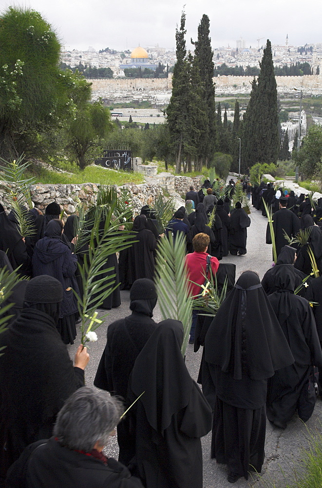 Orthodox Easter Palm procession from Betphage to the Old City walking down the Mount of Olives towards Old City, Jerusalem, Israel, Middle East
