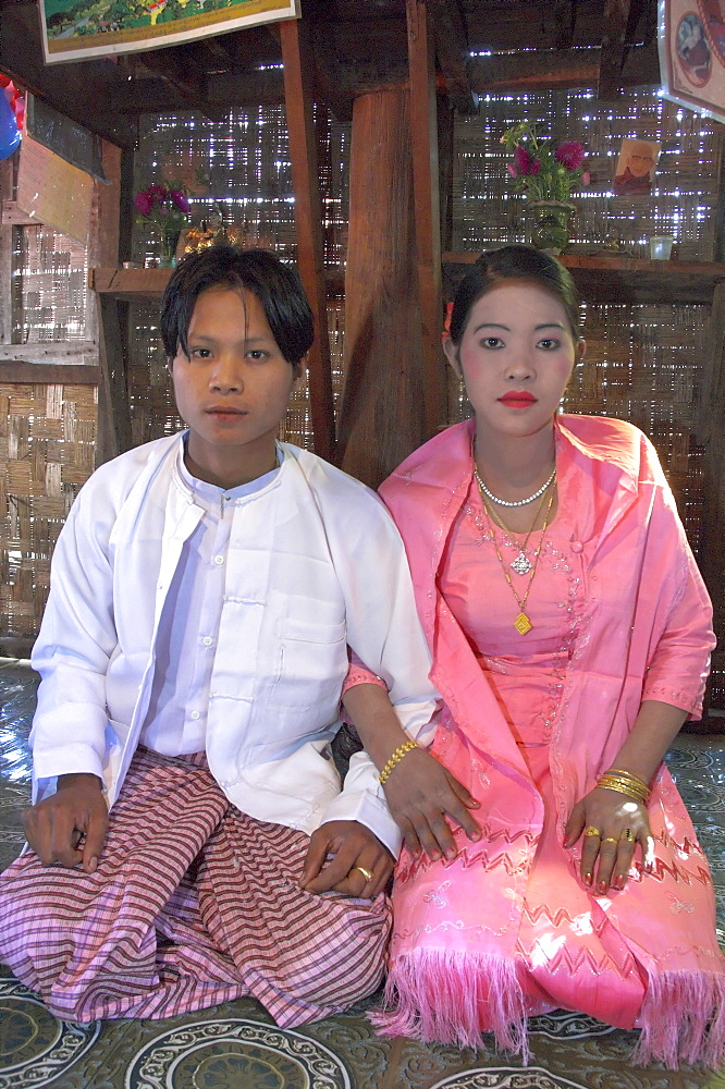 Portrait of bride and groom in their ceremonial dress during their wedding, Lebin, Shan State, Myanmar (Burma), Asia