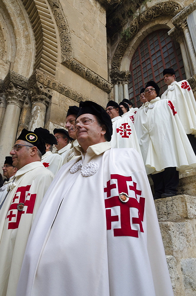 Members of the Order of the Holy Sepulchre pausing in full dress at the Holy Sepulchre, Jerusalem Old City, Israel, Middle East - 557-3393