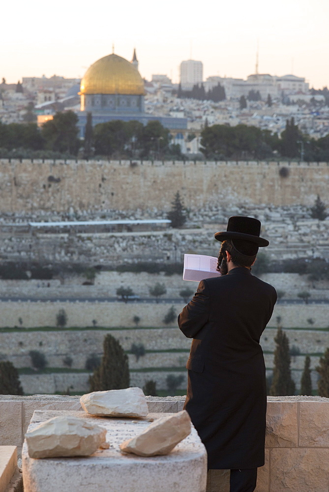 Orthodox Jew praying at Mount of Olives cemetery, Jerusalem, Israel, Middle East