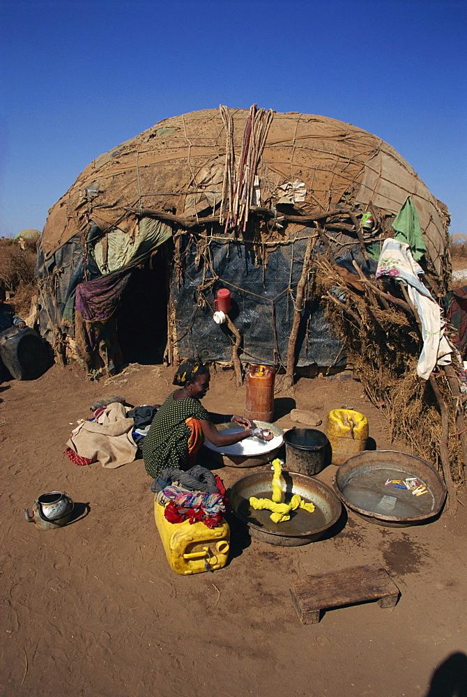 Refugee women washing clothes, Hartisheik Camp, Ethiopia, Africa