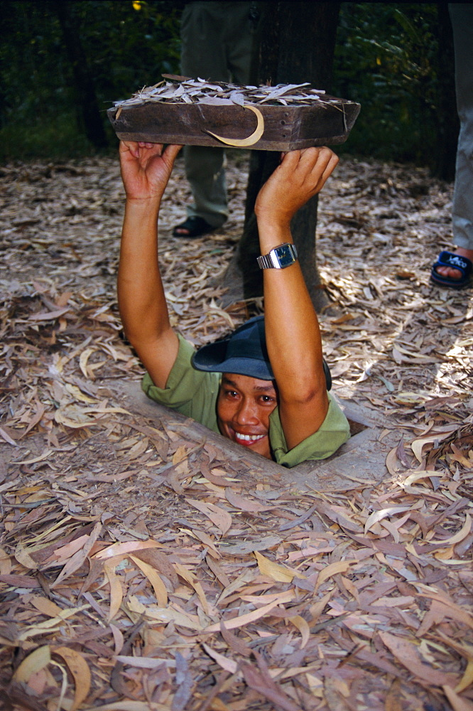 Vietnamese man entering tunnel, Chu Chi tunnels, Vietnam, Indochina, Southeast Asia, Asia