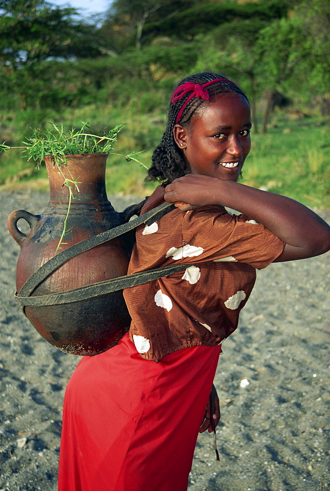 Portrait of woman fetching water, Ethiopia, Africa