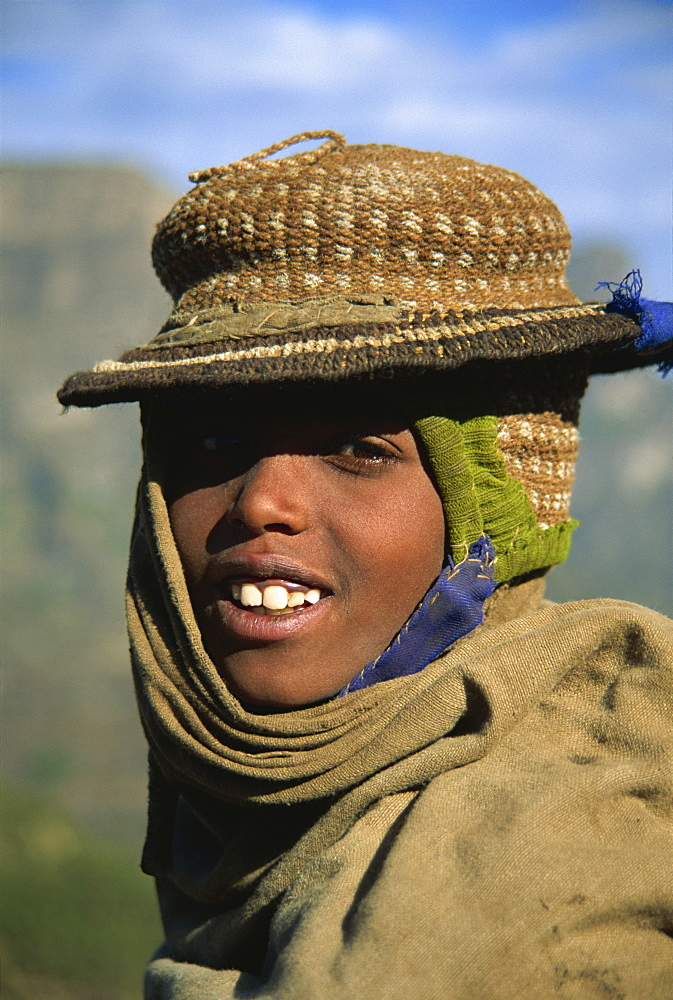 Smiling hill tribe boy with hand woven hat, Simien Mountains, Ethiopia, Africa