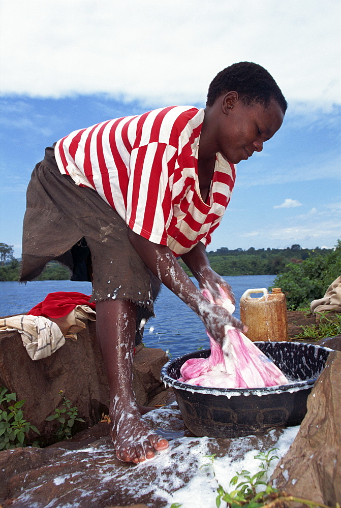 Woman washing clothes, Uganda, East Africa, Africa