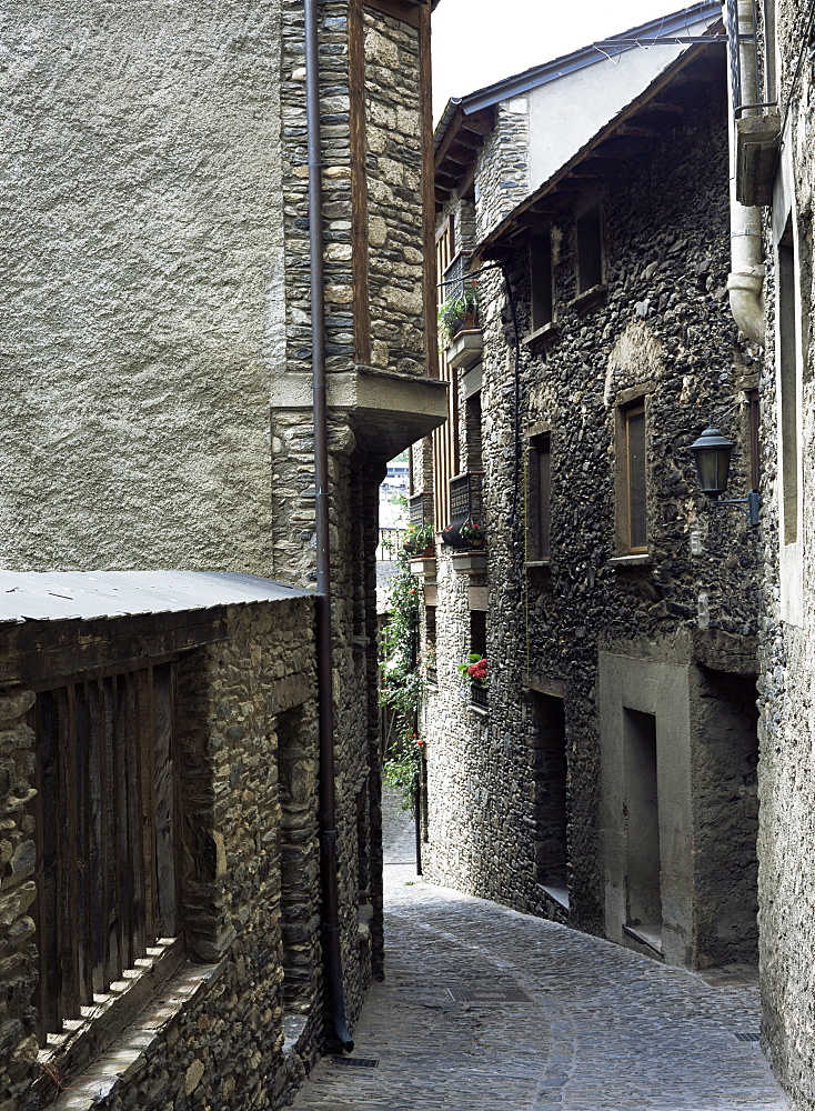 Narrow street in the old part of town, where many houses date from the 17th century, Ordino, Andorra, Europe
