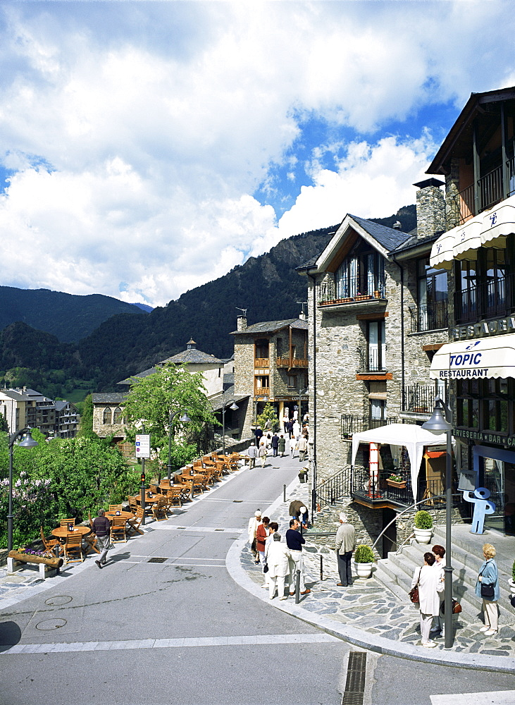 Tourists on pedestrianised street in old part of town, Ordino, Andorra, Europe