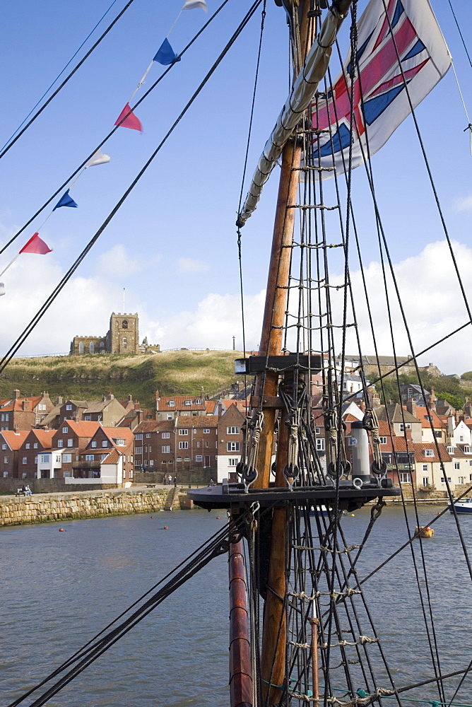 Old Port and St. Mary's church on East Cliff across River Esk, through rigging of replica of Captain Cook's ship Bark Endeavour, Whitby, Heritage Coast of North East England, North Yorkshire, England, United Kingdom, Europe - 586-1371