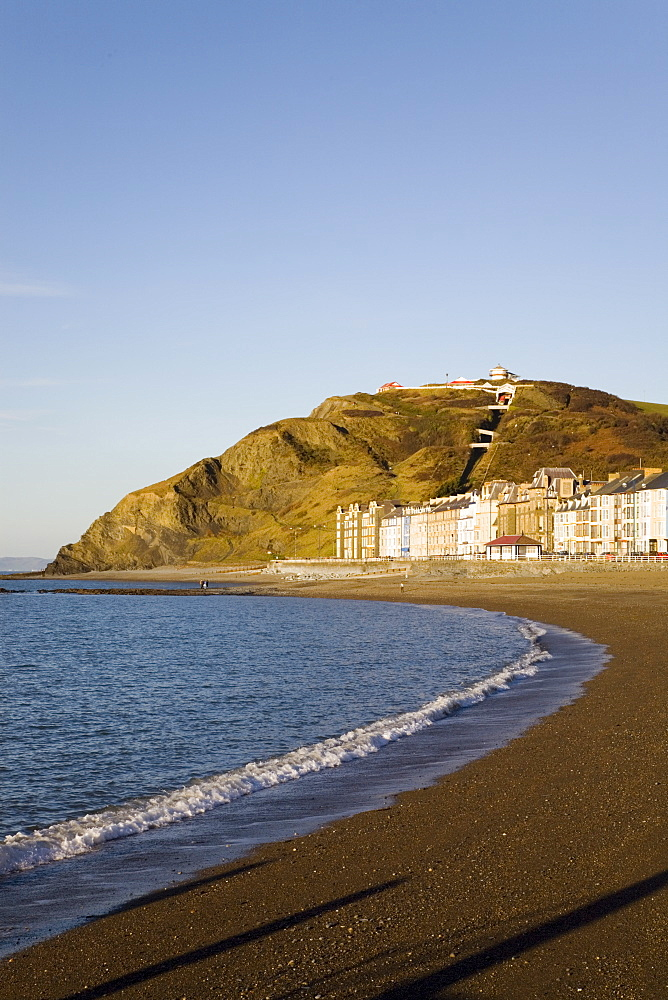 Victorian seafront buildings overlooking empty beach with funicular cliff railway on Constitution Hill in winter light, Aberystwyth, Ceredigion, Dyfed, mid Wales, United Kingdom, Europe - 586-1405
