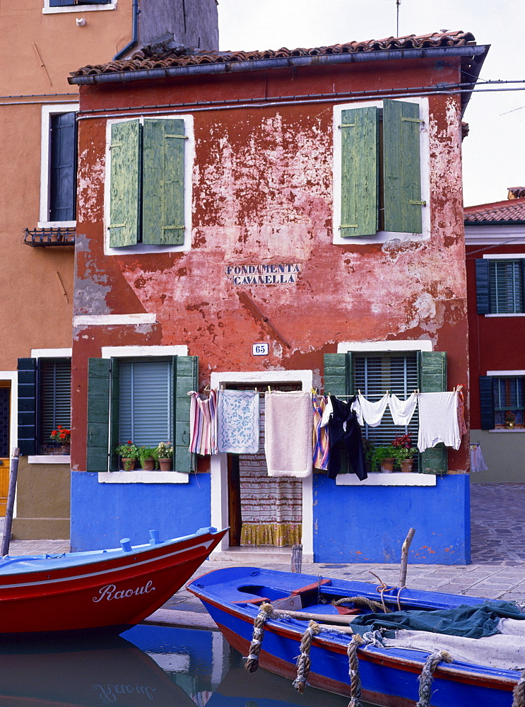A typical canalside house, with washing line, in Burano, Venice, Veneto, Italy, Europe - 59-1308