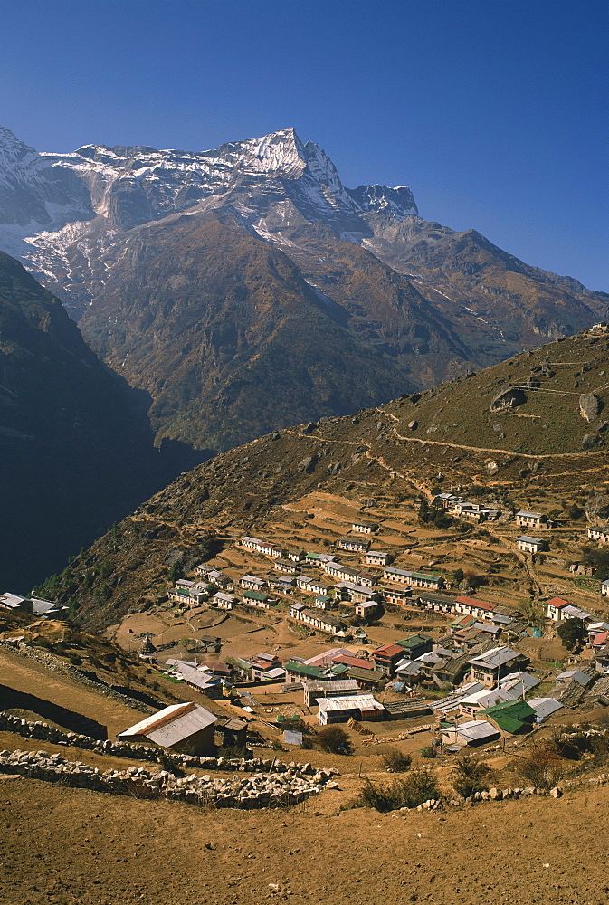 Houses and terraced fields of Namche Bazaar in the Khumbu Region, with mountains in the background, Himalayas, Nepal, Asia