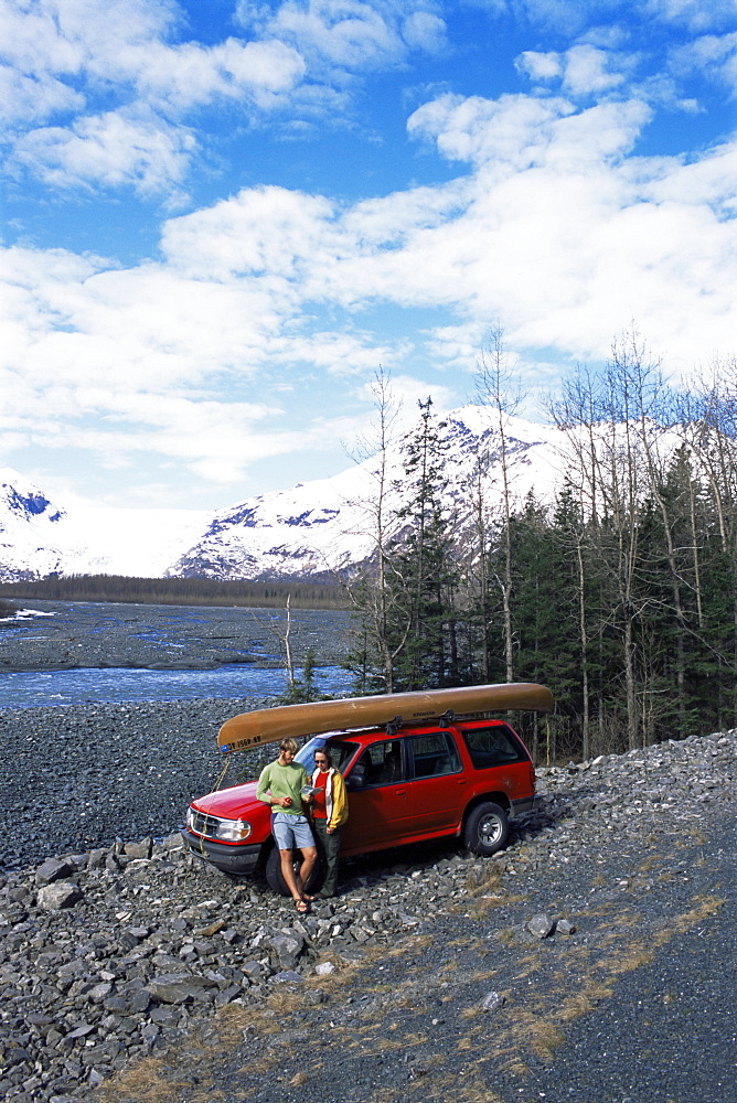 Couple with canoe checking their map at Exit Glacier, off Seward Highway, Seward, Alaska, United States of America, North America
