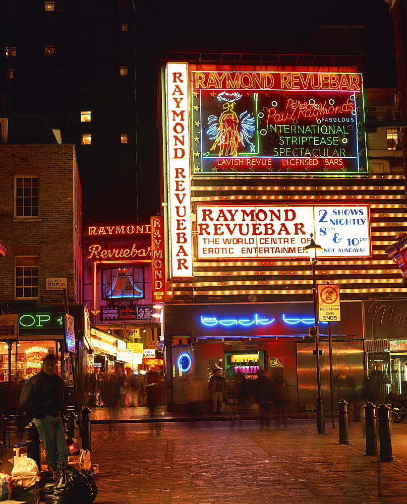 The Raymond Revuebar with neon signs in red light area at night, Soho, London, England, United Kingdom, Europe