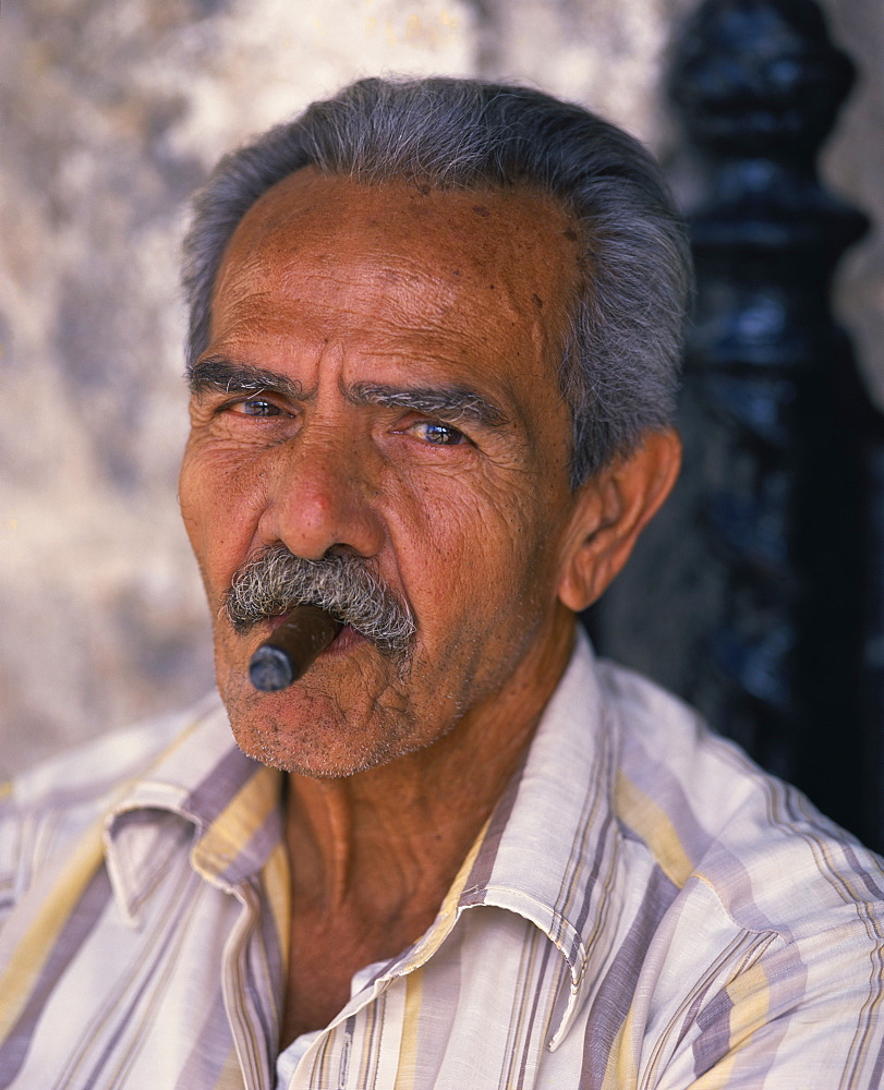 Head and shoulders portrait of an eldery man with moustache smoking a cigar, looking at the camera, Habana (Havana), Cuba, West Indies, Caribbean, Central America - 627-717