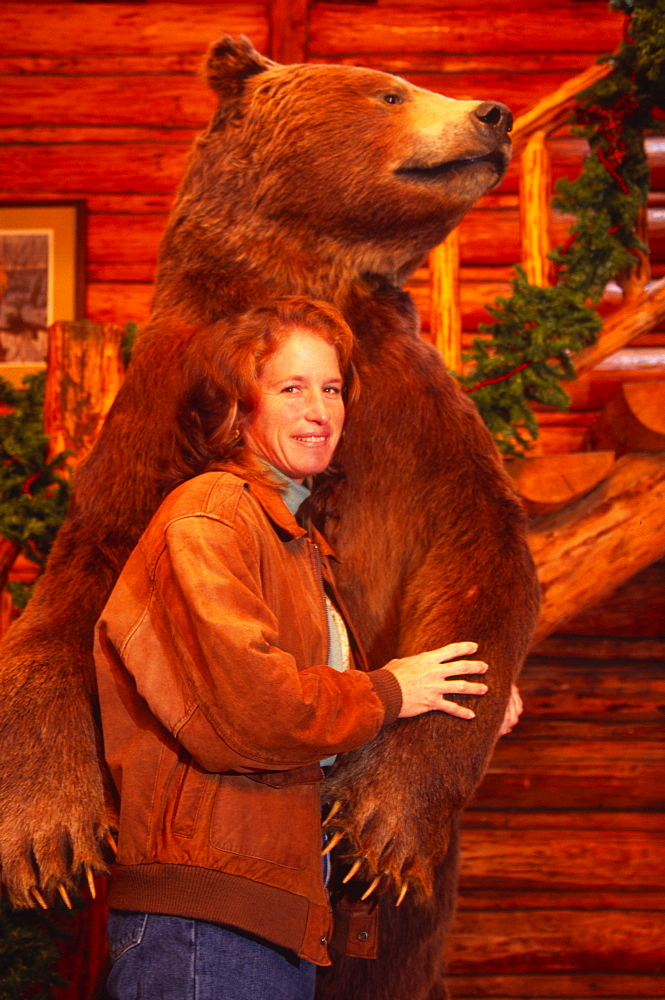 Woman with bear, Canada