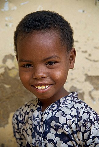 Head and shoulders portrait of an Ethiopian girl, smiling and looking at the camera, Ethiopia, Africa