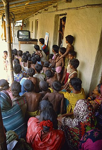 Group of people watching health video, Bangladesh, Asia