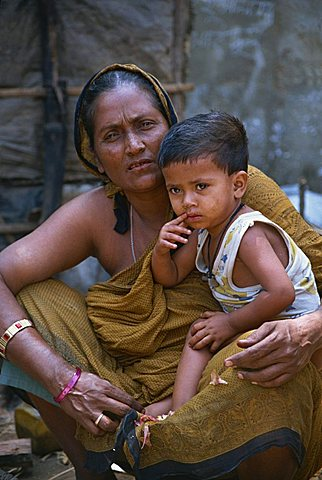 Mother and son in a slum in Dhaka, Bangladesh, Asia