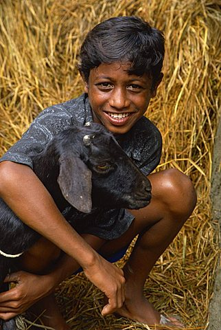 Boy and goat, Char Kukri Mukri, Bangladesh, Asia