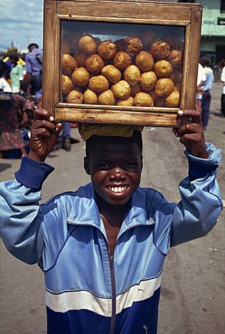 Boy selling bean cakes, Monrovia, Liberia, West Africa, Africa