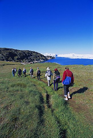 Tourists walking towards the icefjord at Sermermiut, Ilulissat, formerly Jacobshavn, Greenland, Polar Regions