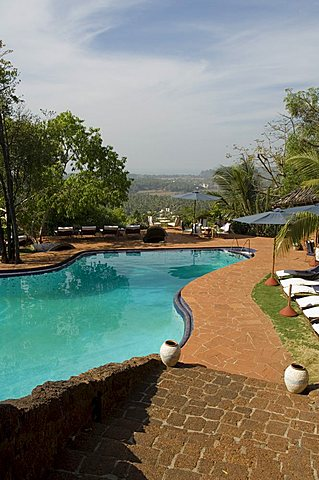 The swimming pool at the Nilaya Hermitage, a boutique hotel, Goa, India, Asia