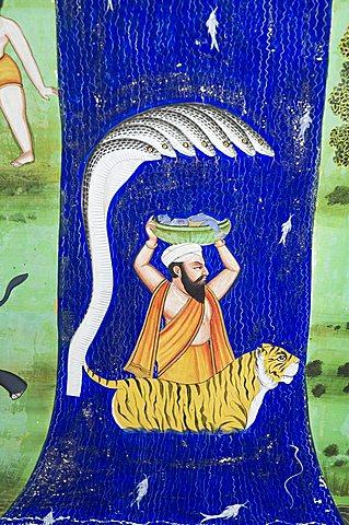Beautiful mughal frescos on walls of the Juna Mahal Fort, Dungarpur, Rajasthan, India
